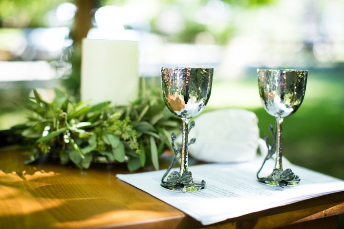 Kiddush Cups And A Memorial Candle At Wedding Ceremony