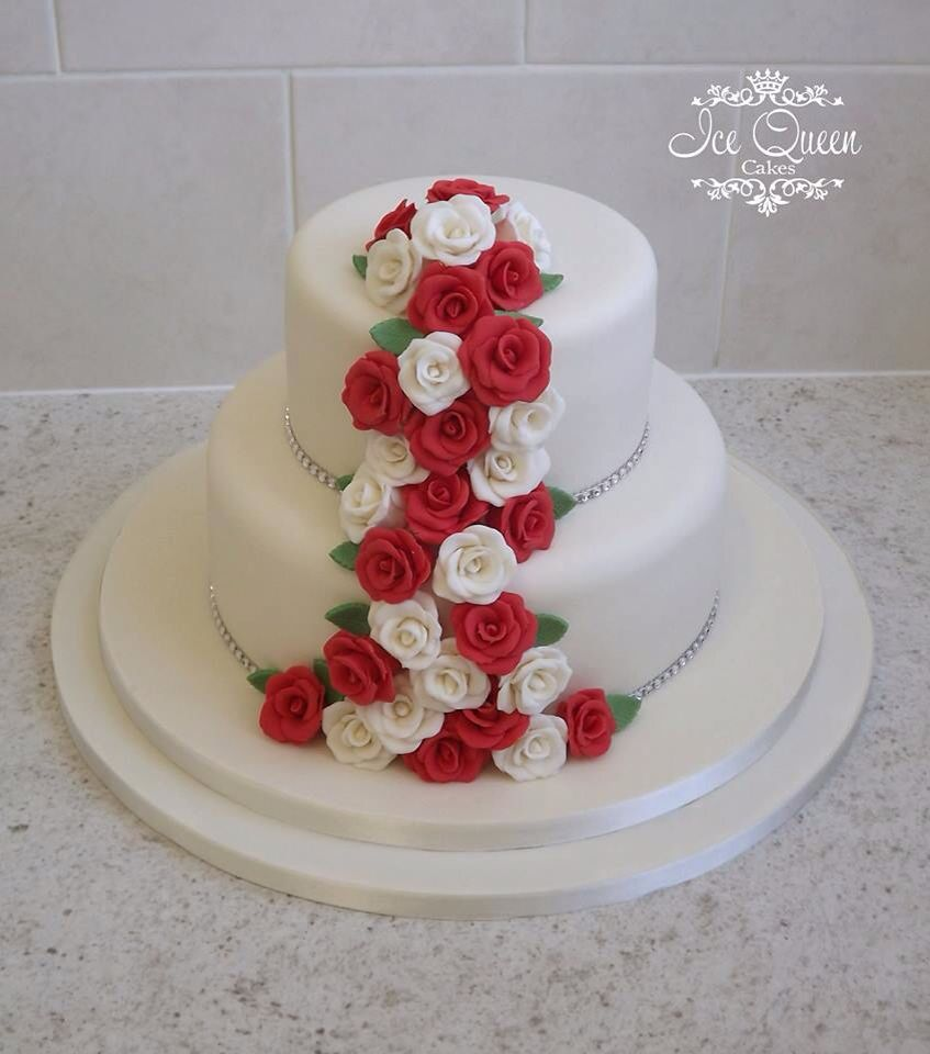 2 tier small wedding cake with red & ivory cascading red