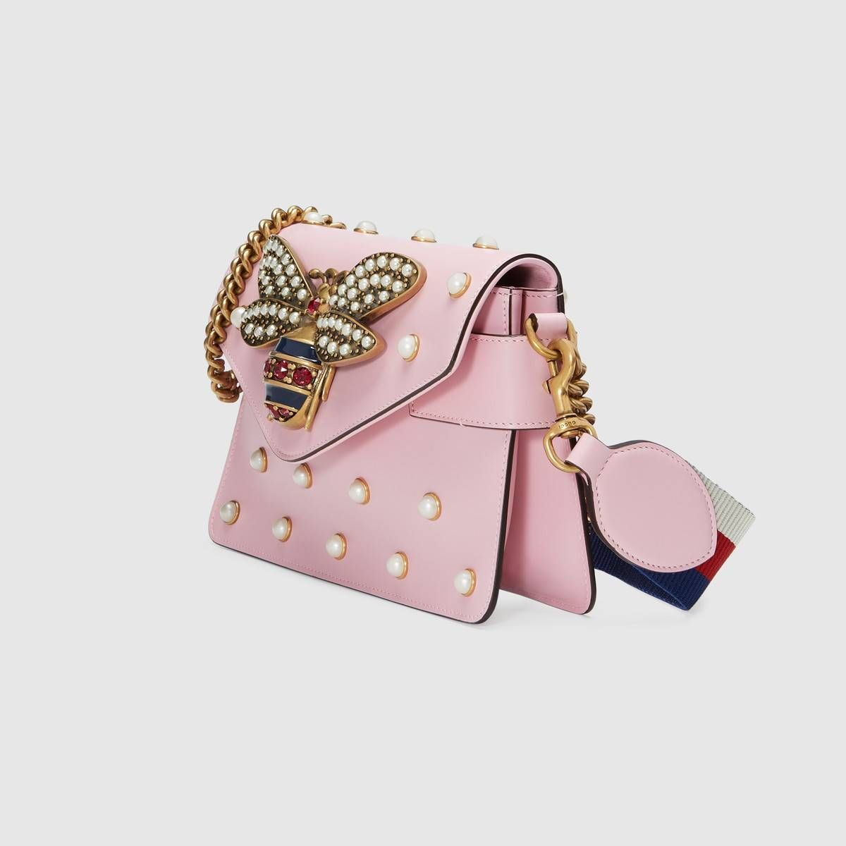 c4c93b26c26b Shop the Broadway leather mini bag by Gucci. A mini bag with pearl studs  and metal bee detail. The bee s striped body is highlighted with blue  enamel and ...