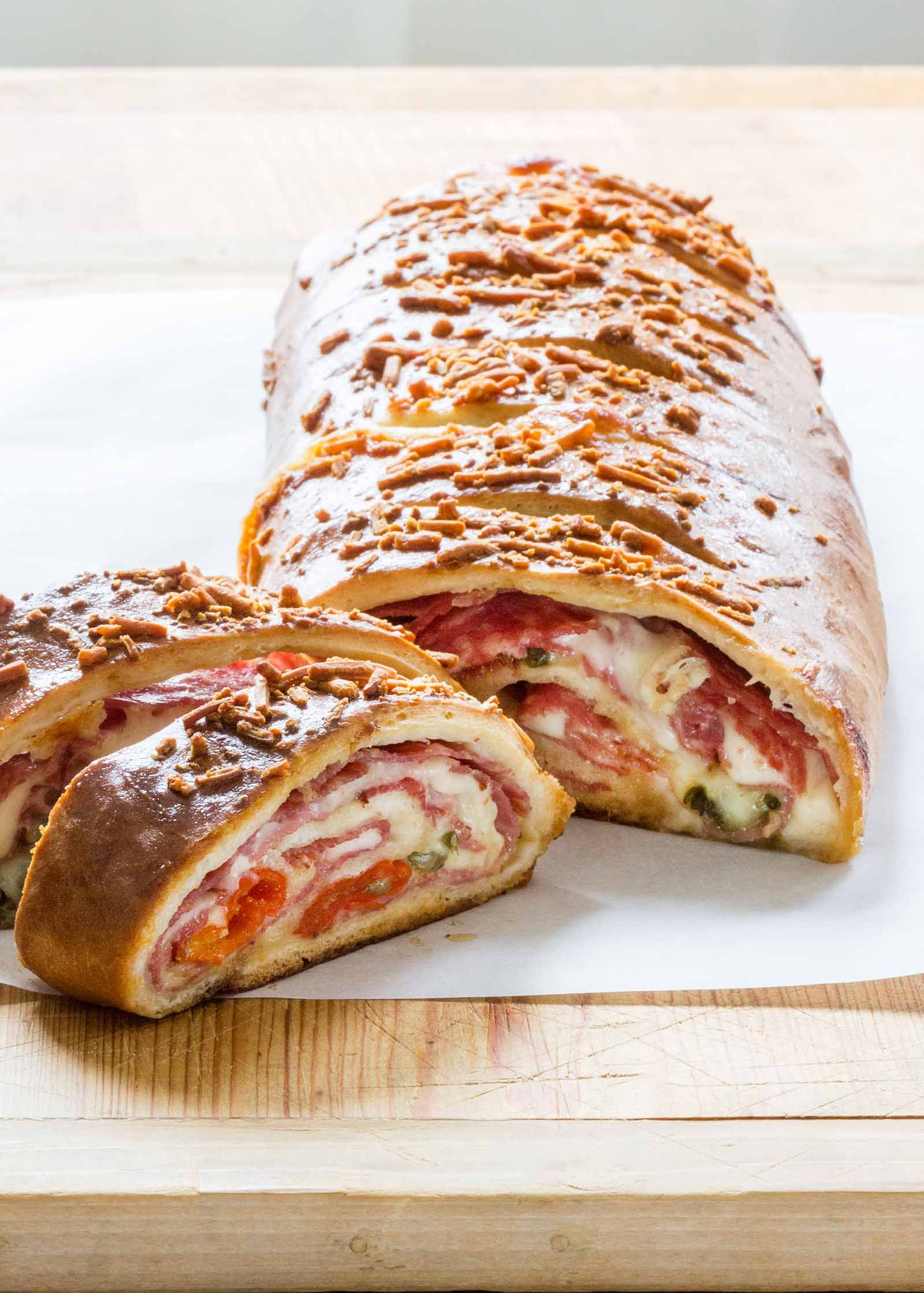 This meat and cheese-stuffed stromboli will feed a crowd! Ham, salami, provolone, and mozzarella get rolled up in pizza dough. Easy to make, easy to share. #Stromboli #ItalianFood #Dinner #Cheesy #simplyrecipes