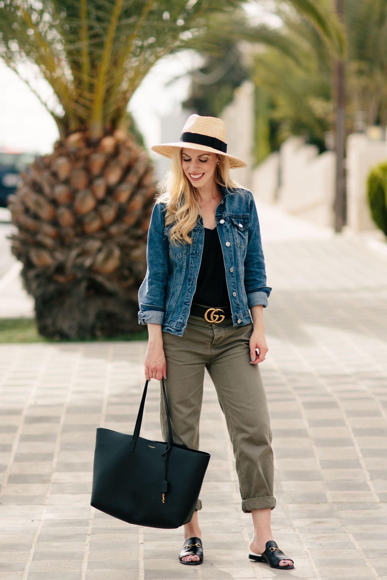 31a1782c1354c Summer Casual: J. Crew denim jacket with Gucci belt, chino pants and Gucci  slide sandals, Saint Laurent shopping tote, denim jacket with straw hat  summer ...