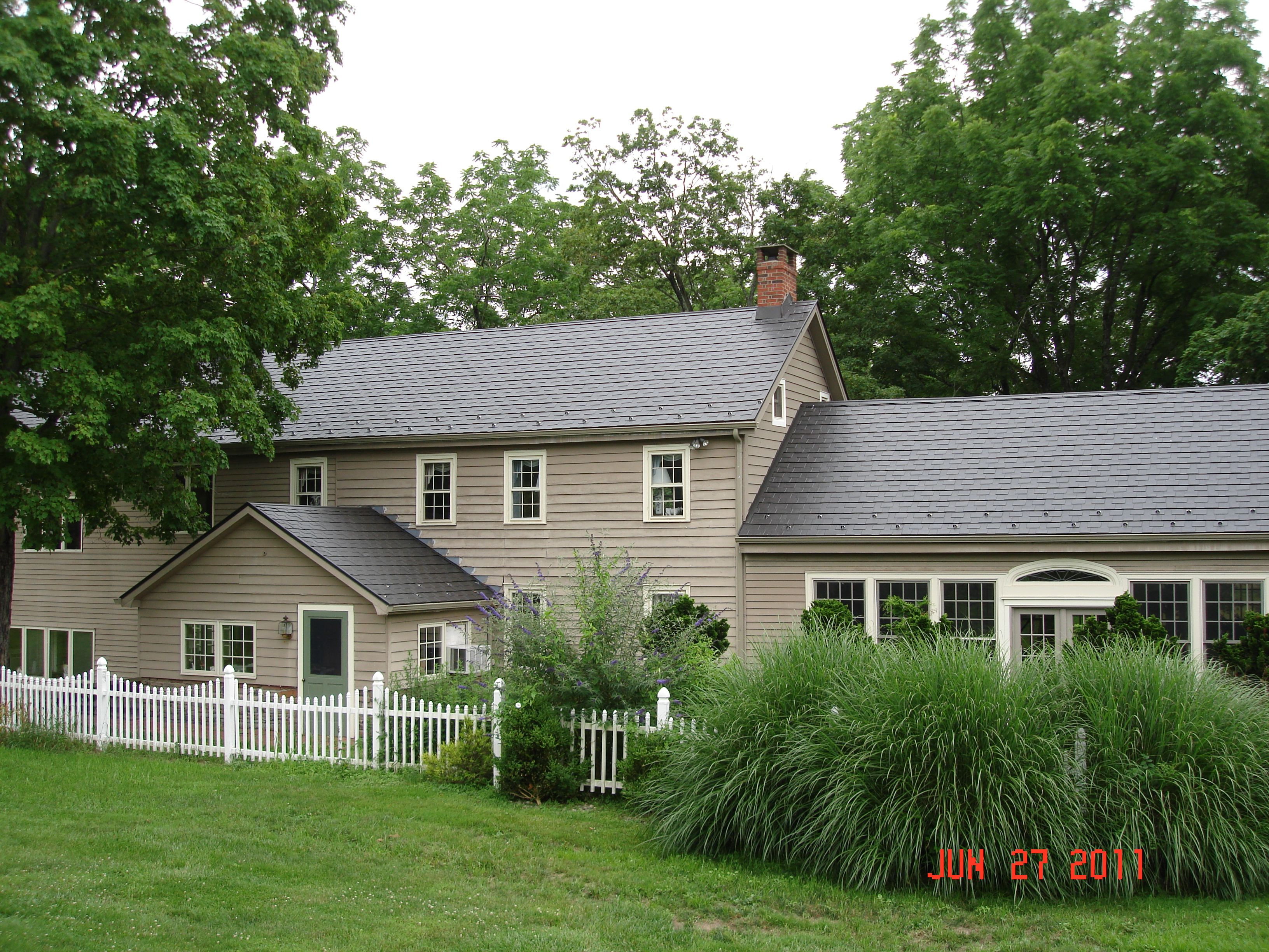 How To Choose Between Standing Seam And Metal Shingle Roofing Metal Roof Colors Metal Shingle Roof Standing Seam
