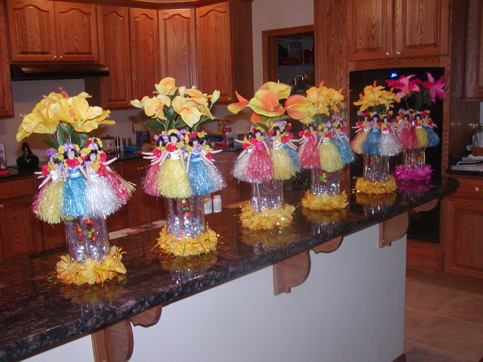 A Little Over The Top But Like Idea Of Flowers At Base Luau CenterpiecesLuau Decorations21