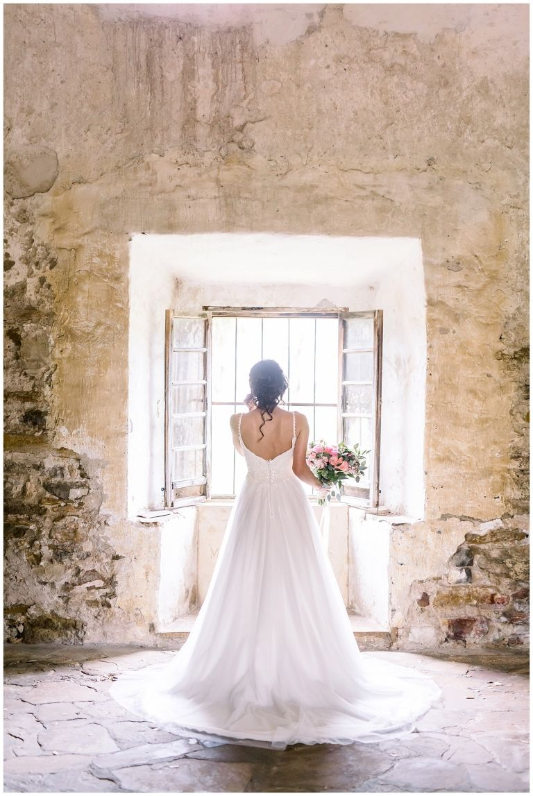 Bride Standing By A Window For Her Spanish Missions Bridal Portraits In San Antonio Tx With Monic Bridal Portraits Timeless Wedding Dress San Antonio Weddings [ 1147 x 768 Pixel ]