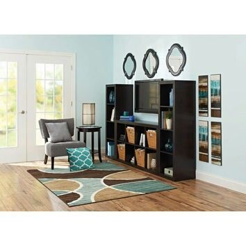 Make your own entertainment center with cube shelves from - Storage units living room furniture ...