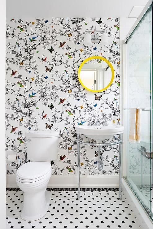 A round canary yellow mirror adds a lively pop of color in