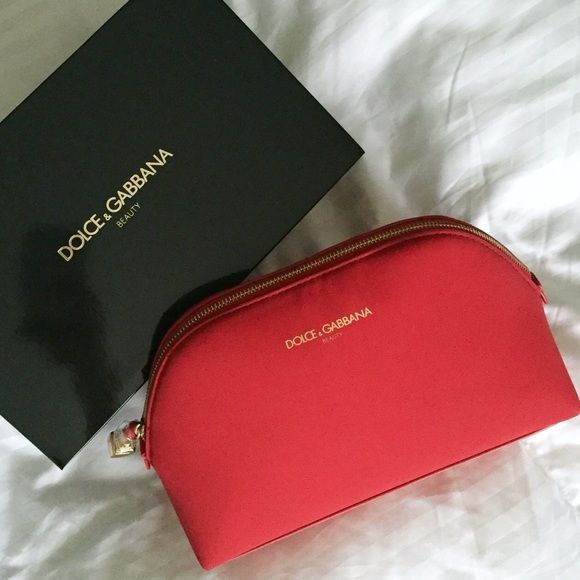 "Dolce & Gabbana red travel beauty bag w/ charm Sexy red hot Dolce & Gabbana travel beauty bag w/ lipstick charm. New in box. H 5.5"", L 8.5"", W 3"". Lowest! Dolce & Gabbana Bags Travel Bags"