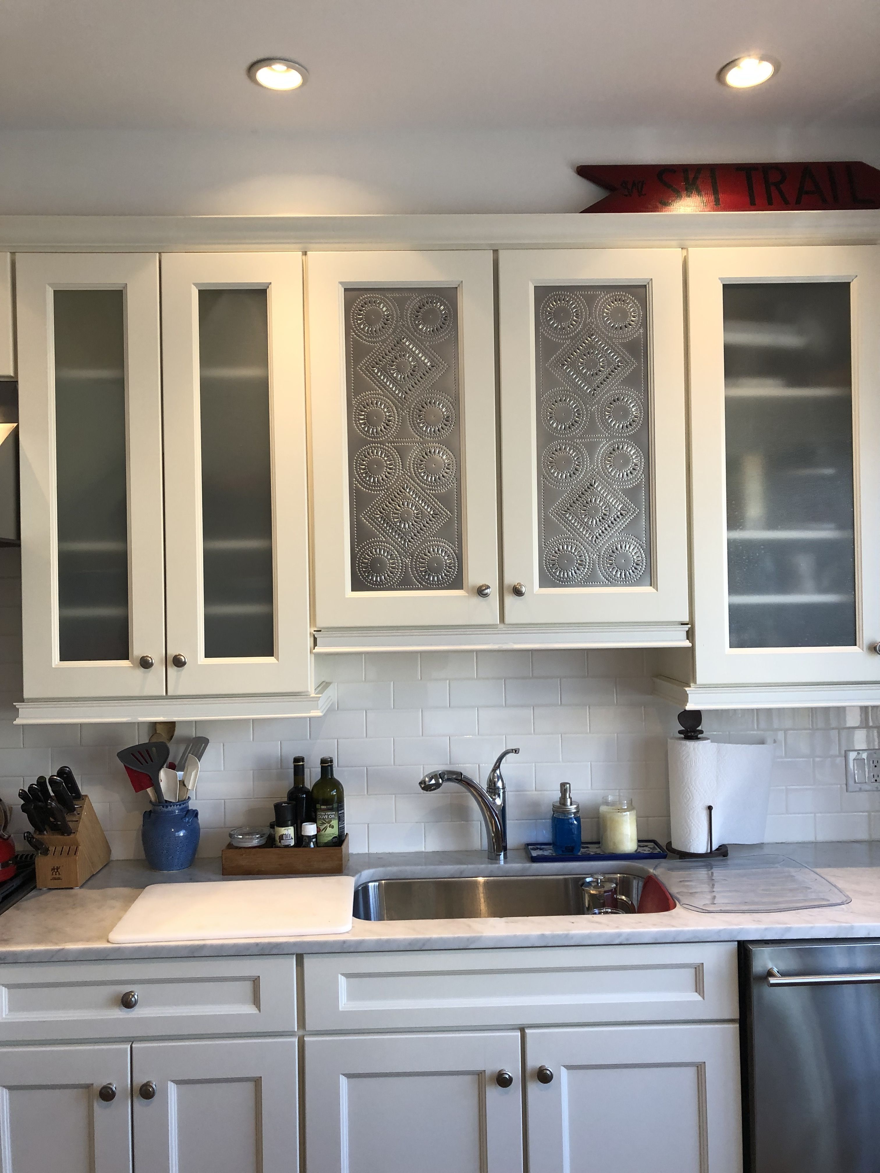 Moving From Builder S Spec To Farmhouse The Builder S Kitchen Cabinets After The Dyi Project Of Covering The Glass With Pi Kitchen Cabinets Kitchen Tin Panel