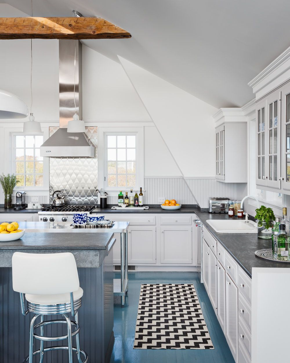 Mix of materials in this bright blue and white kitchen in a beach ...
