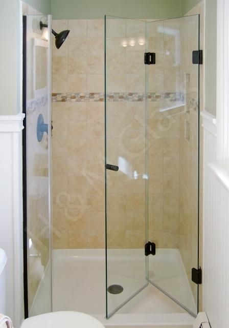 Shower Door Inspiration Check Out This Bi Fold Frameless Shower Door Shower Remodel Shower Renovation Bathroom Remodel Small Shower