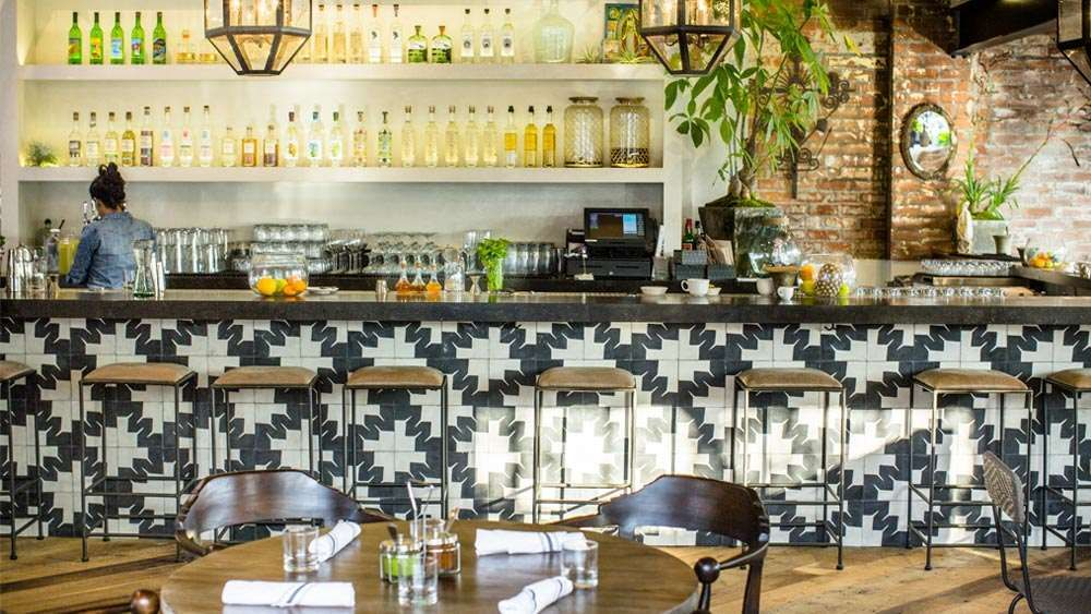 I Love The Feel Of This Counter With The Plants The Tile On The Vertical Surfaces The Open Shelving Restaurant Tiles Restaurant Decor Mexican Restaurant