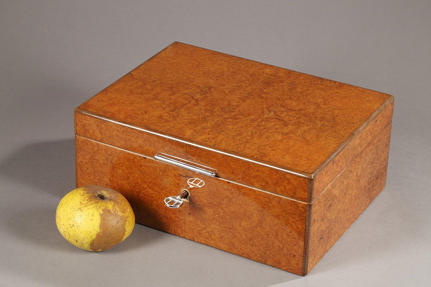 """A late 20th century Dunhill wooden cigar box with its original key, provided with a humidor. Opal glass interior. It can receive 50 cigars. Marked """"Dunhill PARIS"""" inside.Circa :1970Dim: W: 10,2 in - D: 7,9in - H: 4,3in.Dim: L:26cm, P:20cm, H:11cm. #art #gallery"""