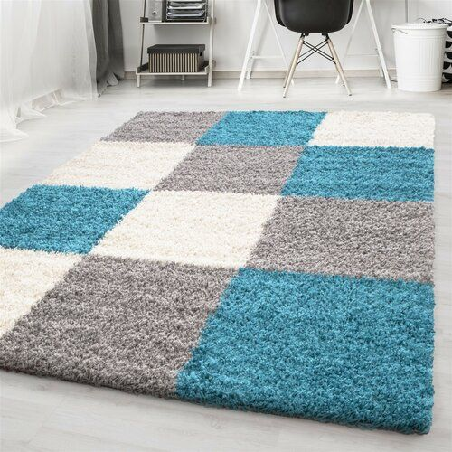 Zipcode Design Enjoy comfort and contemporary style in your home with this area rug. Made with an inviting, deep pile, it has an eye-catching design made of squares in different neutral colours with pops of bright turquoise. This is a great choice of comfortable rug for those who enjoy modern and minimal décor. A rug gripper is recommended to avoid slipping. Rug Size: Rectangle 80 x 150cm