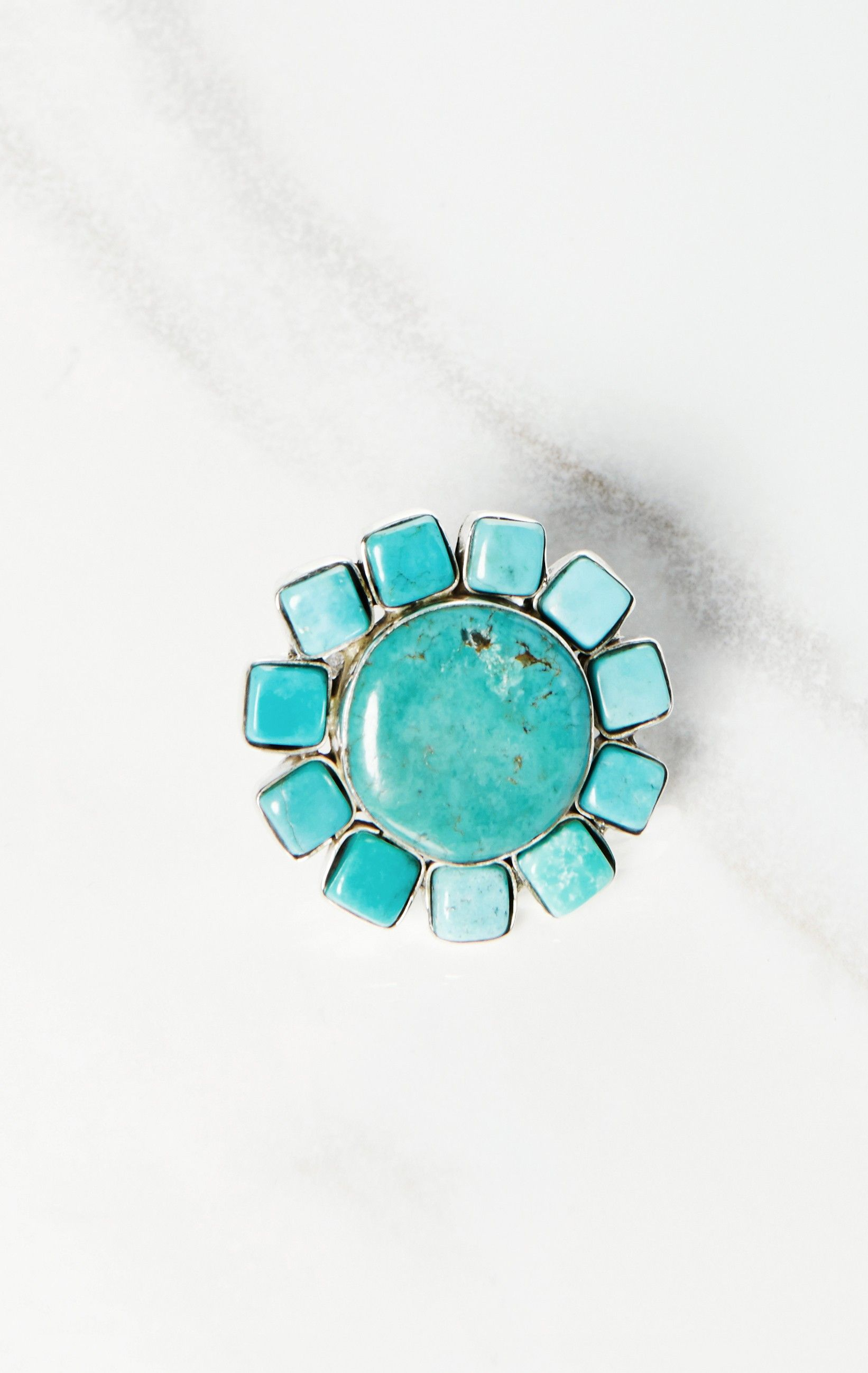 The Natalie B Jewelry Desert Flower Ring is a handmade genuine Chinese turquoise and sterling silver ring with adjustable closure and multi-stone accents. Complete the look with your other Natalie B Jewelry favorites.  Made in USASterling Silver, Turquoise