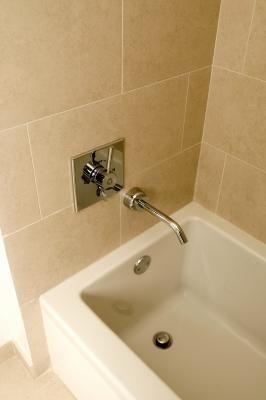 how to tile around a bathtub edge