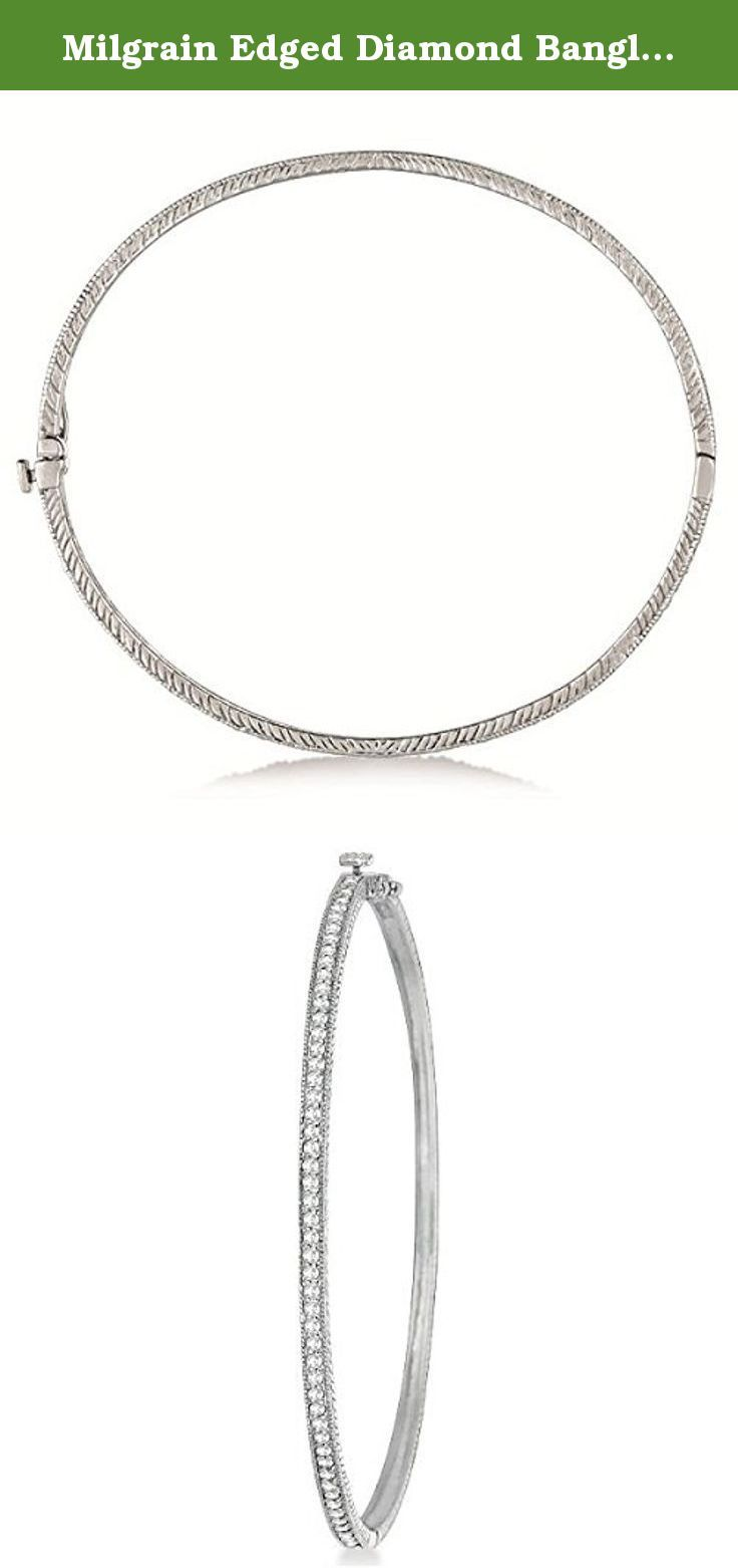 Milgrain Edged Diamond Bangle Bracelet Bracelet 14k White Gold (0.75ct). Scroll work design and milgrain edges accompany 51 brilliant-cut round diamonds that go half-way around a stackable bangle bracelet crafted in 14kt white gold. Each stone featured in this unique bracelet is a bright near-colorless diamond of G-H Color and SI Clarity. The slightly oval shape makes for a better fit around your wrist. Wear it alone or mix and match with our other stackable bangles.
