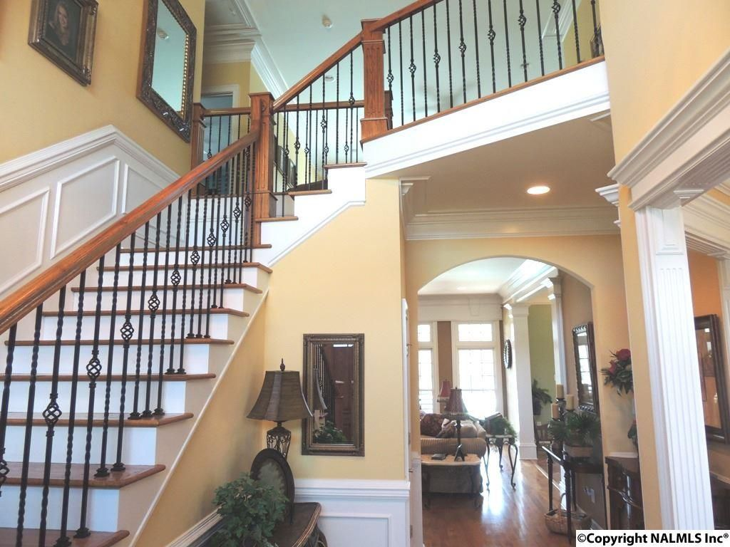Elegant Traditional Staircase With Crown Molding, Hardwood Floors, High Ceiling,  Wainscoting