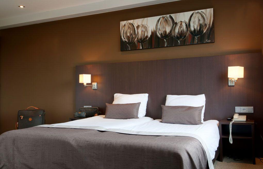 Het bed in een van de comfort kamer in het Hampshire Hotel - Groningen Plaza.