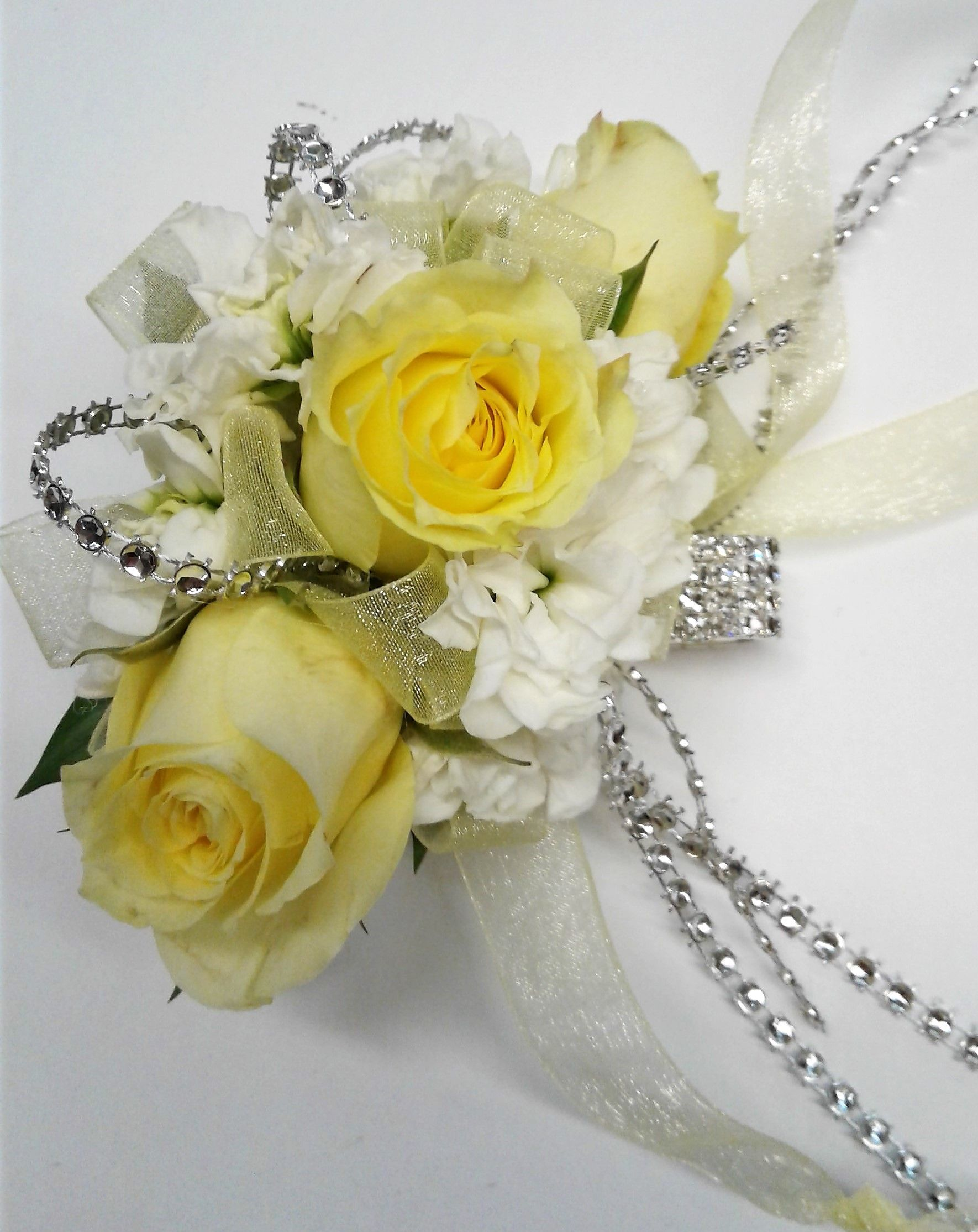 Wrist Corsage With Yellow Spray Roses And White Stock Blooms