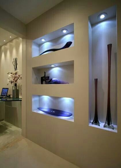 These niches take on a whole new personality with cool white accent lighting