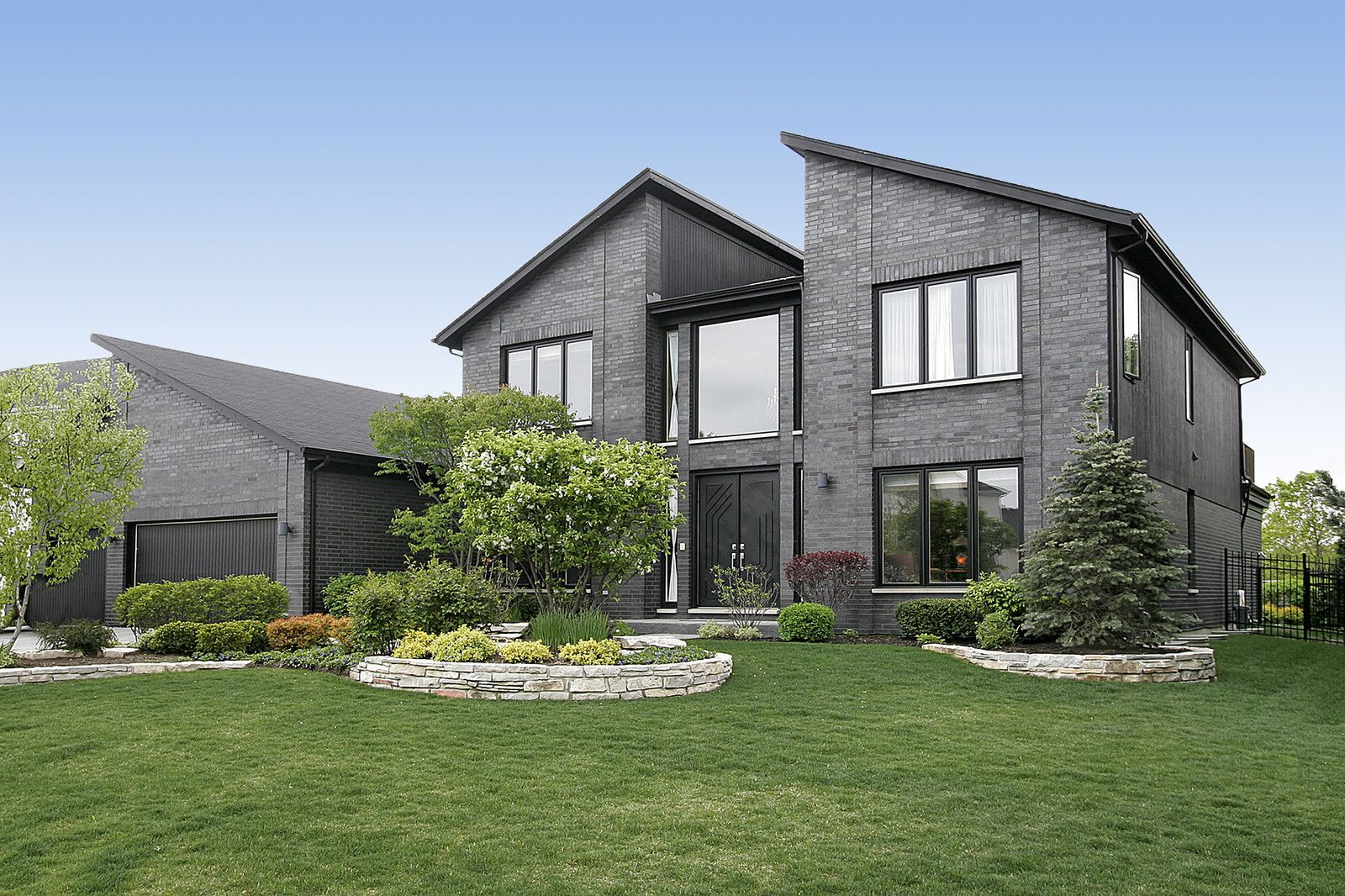 Wenatchee real estate offices free home design ideas images - Modern Home With Gray Brick And Black Door Stock Photo