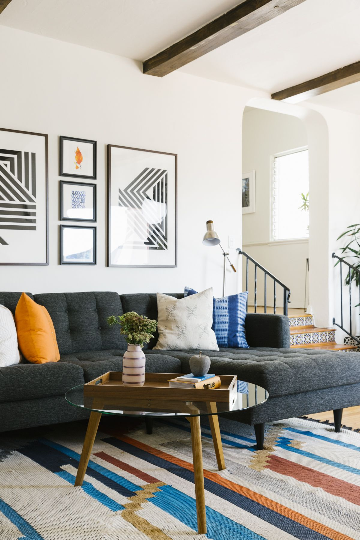 An Eclectic And Masculine Design In Los Angeles Havenly S Blog Modern Grey Living Room Condo Living Room Mid Century Modern Living Room