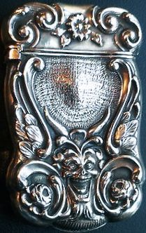 Unger Brothers sterling silver match safe, flowers and winged, green man mask.