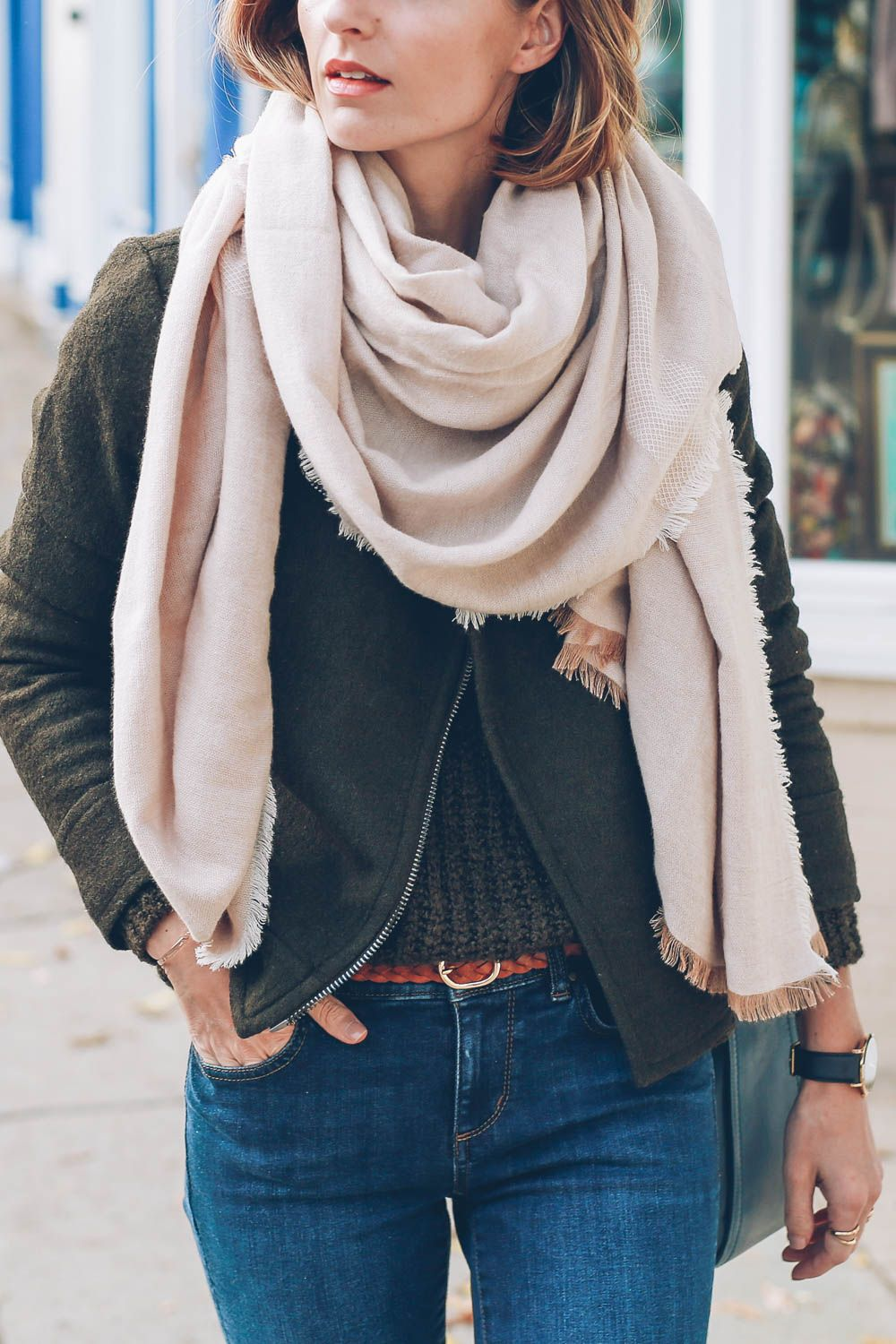 Jess Kirby wearing a cozy blanket scarf and wool moto