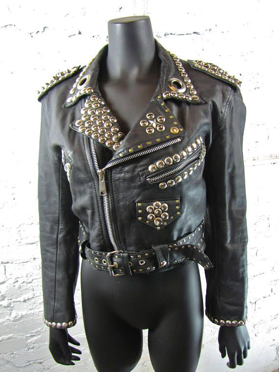 Hand Stitched Black Genuine Elegant Leather Jacket Golden Studded For Women100 % Genuine Cowhide LeatherFine premium stitchingInner Lining & inside PocketClassic Fashionable Studded WorkWomen Black Color Leather Jacket With Gold StudsCustom Color Changes option is availableCustomized Size option is availableCustom Design option is also availableCustom Logo can be placed on the jacket if required.C..