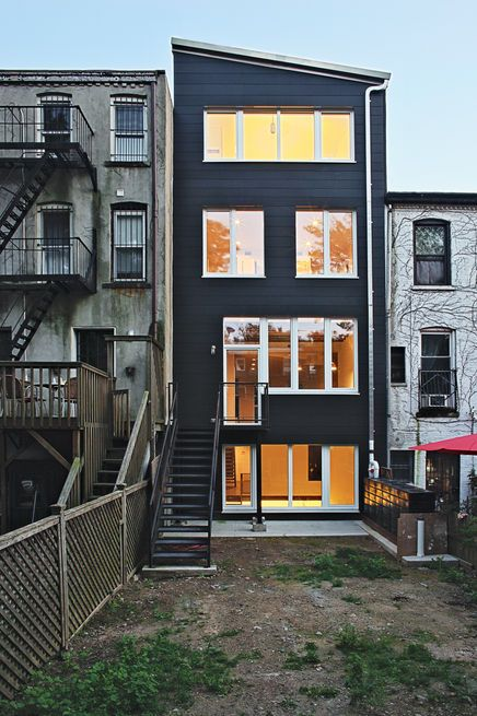 The Rear Facade, Like The Top-floor Addition, Is Faced In