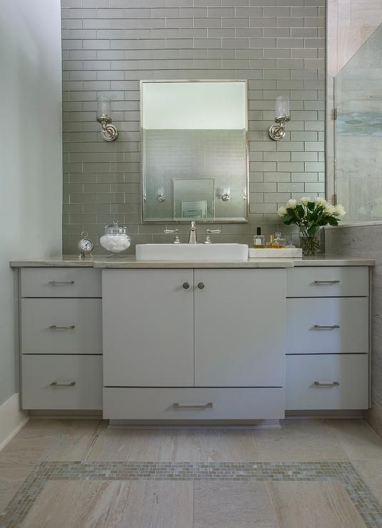 Blue and gray bathroom features a blue washstand fitted with flat front cabinets doors and drawer & Blue and gray bathroom features a blue washstand fitted with flat ... azcodes.com