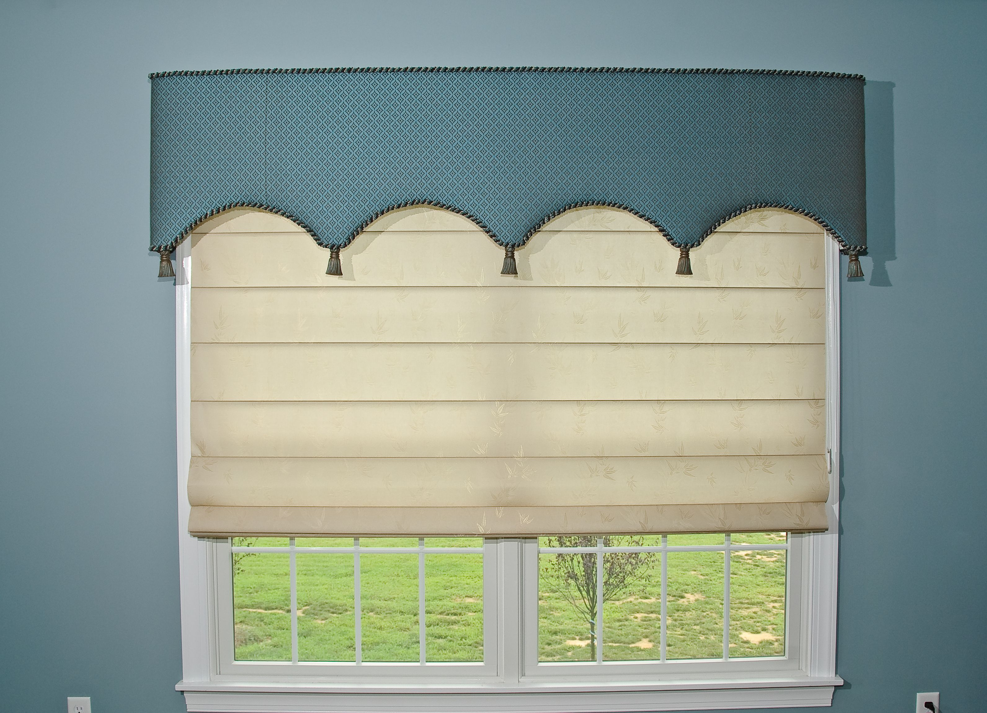 Arched bottom cornice with tassels and corded edge window treatment