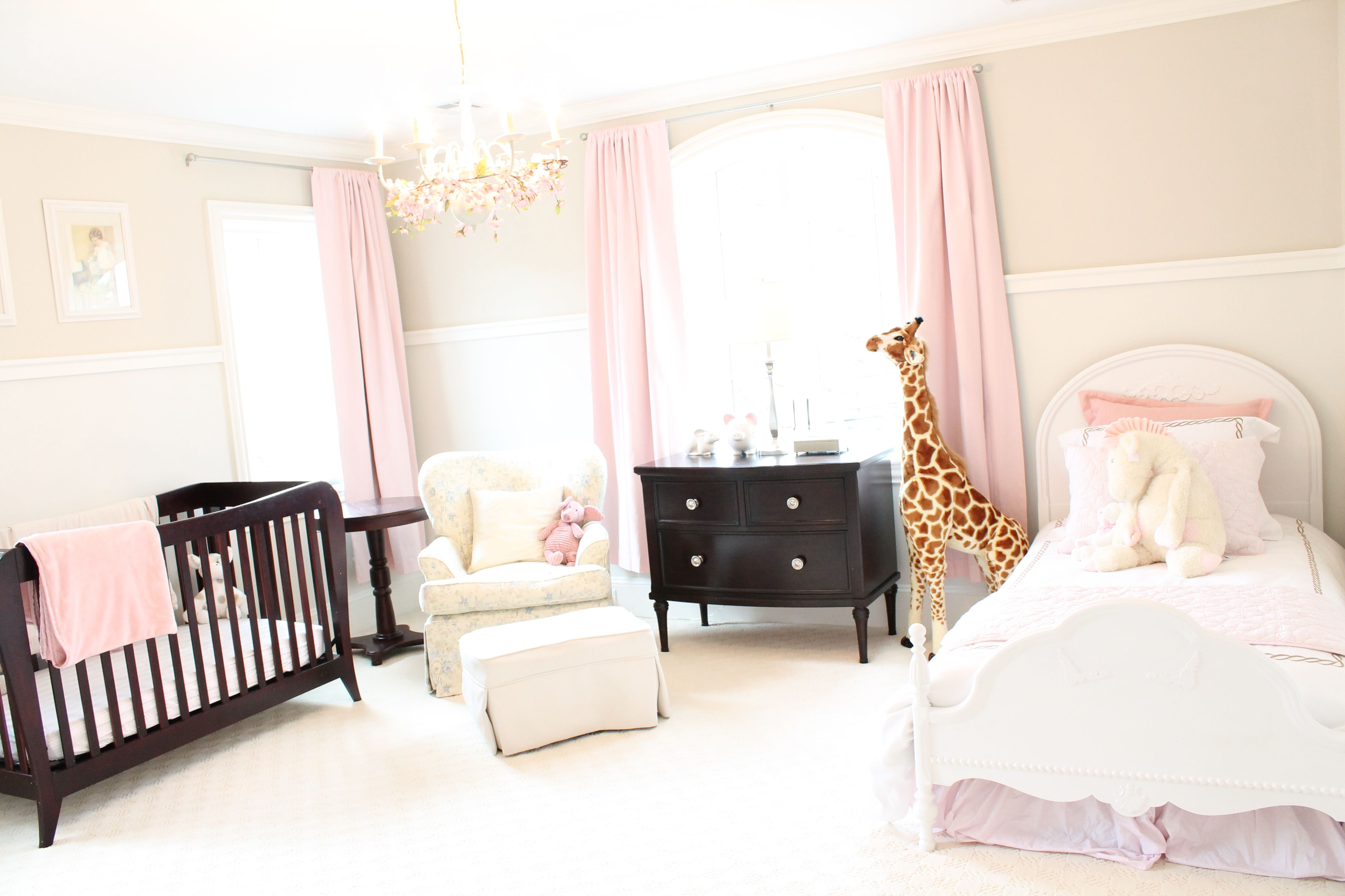 An elegant pink nursery fit for a little princess . The