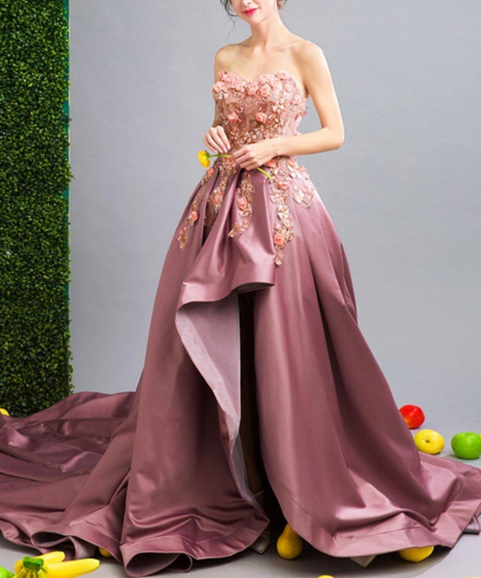 Take a look at this magenta floral silk hilow gown today wedding