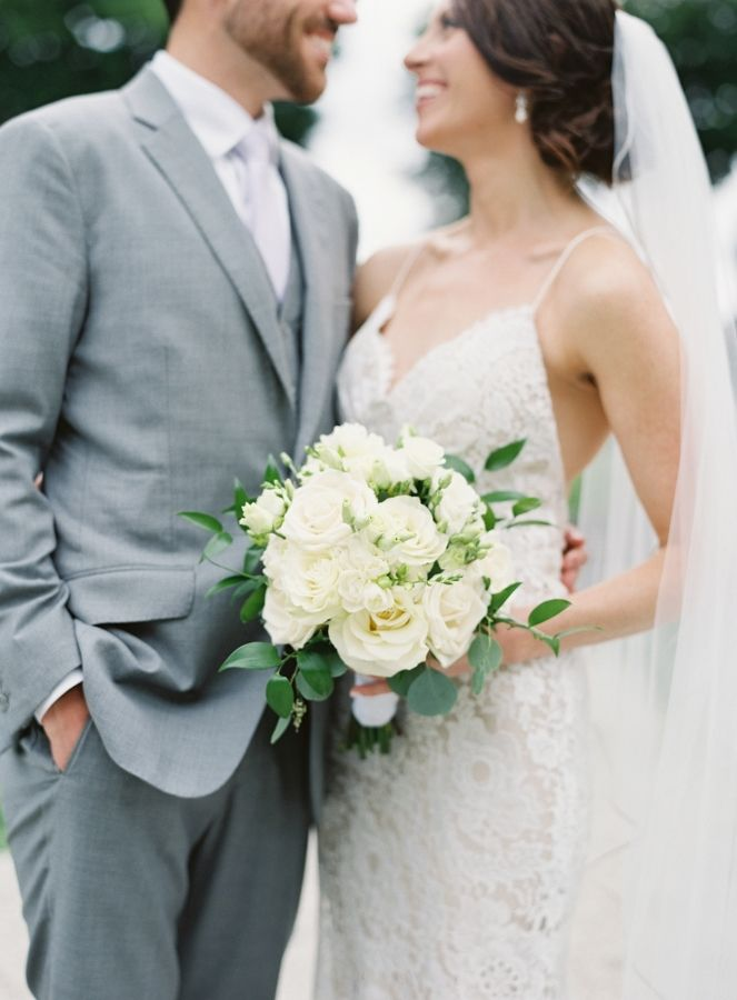Classic ivory and eucalyptus wedding bouquet: http://www.stylemepretty.com/illinois-weddings/lake-forest/2016/09/29/the-reasoning-behind-this-brides-white-feather-will-make-you-cry/ Photography: Jacqui Cole - http://jacquicole.com/