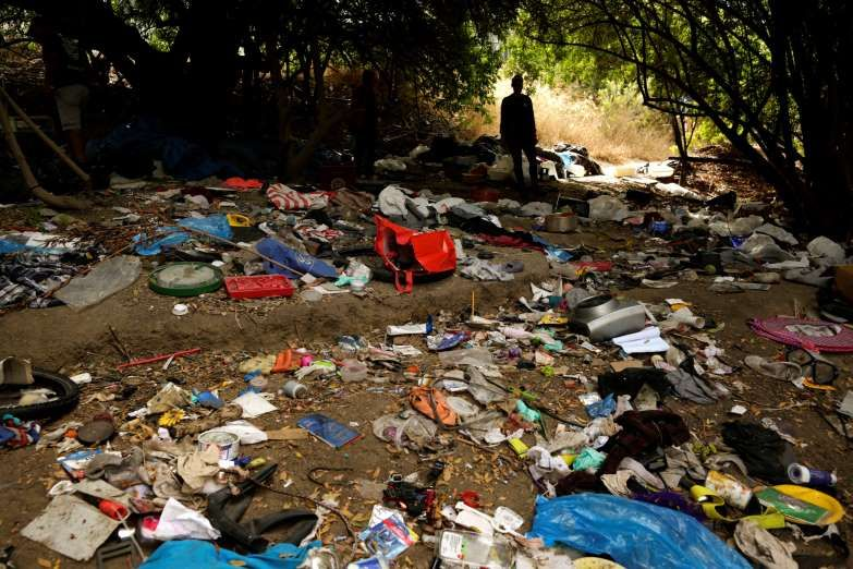 A Woman Looks Over Trash From An Encampment For Homeless People Along The San Diego River In San Die The Associated P Health Issues Public Health Homeless
