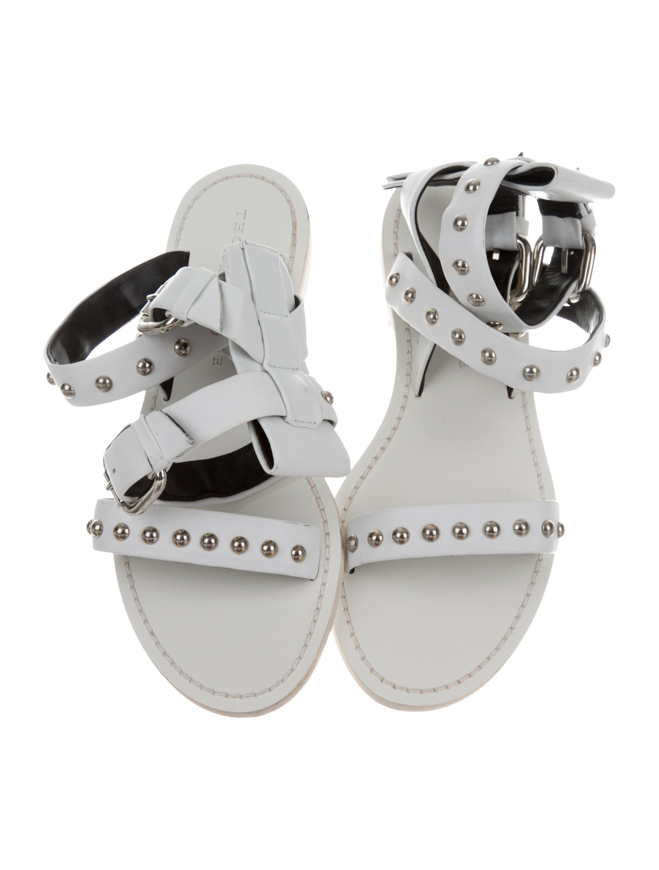 c7d1ff1e07b5 White leather Thomas Wylde studded sandals with stacked heels and buckle  closures at ankles. Includes