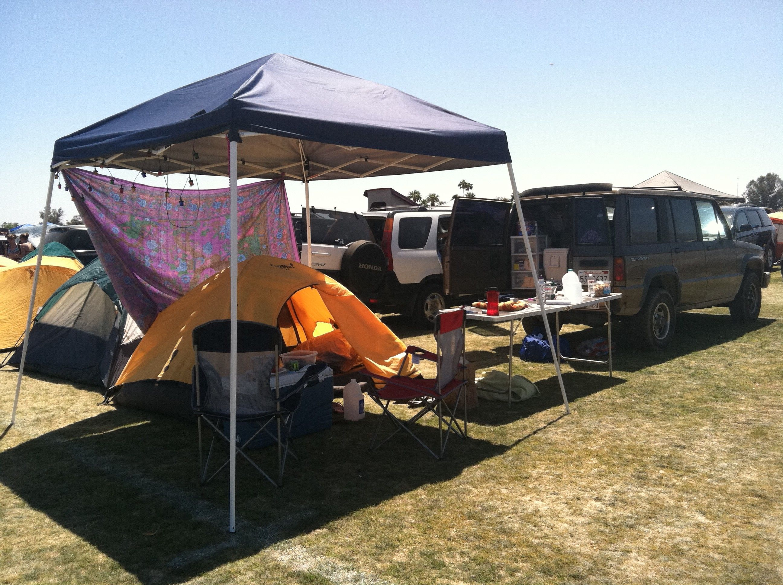Coachella car camping use sheets or shower curtains for privacy protection from sun