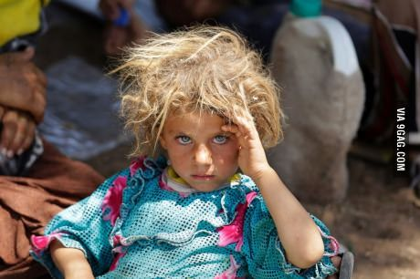 Yazidi girl rests after fleeing ISIS. I feel like this will become an iconic image.