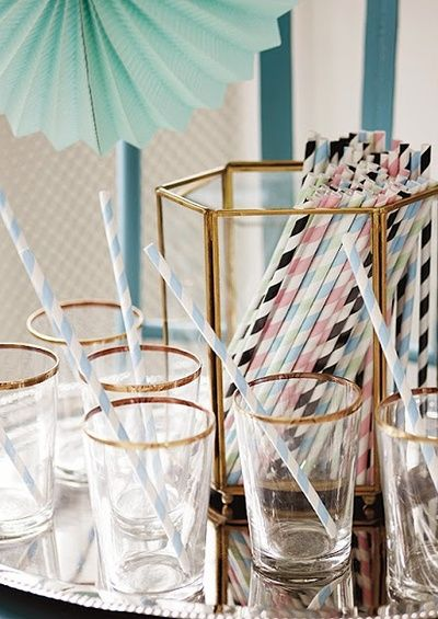 Striped Straw and gold rimmed glasses