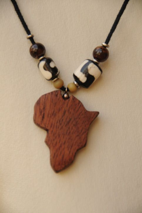 Wooden africa pendant necklace from kirabo seeds store envy cord holding a few painted wood beads and or boneclay beads with a wooden africa in the middle online store powered by storenvy mozeypictures Choice Image