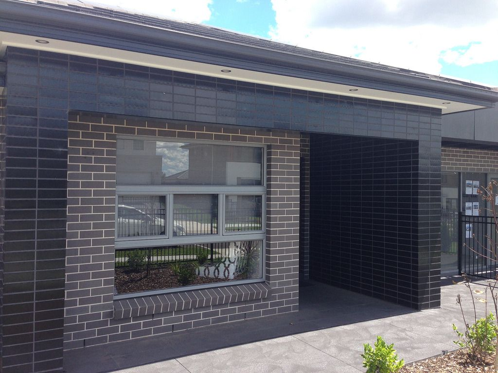 Austral Bricks Charming Black Exterior House Design