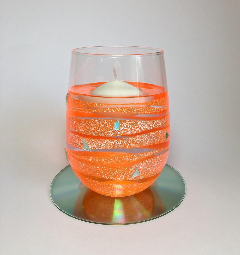 Tangerine Floating Candle Holder | this project features a wine glass, old DVD, and airbrushing to create this lovely effect.