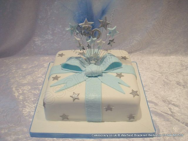 White blue and silver celebration birthday cake decorated ...