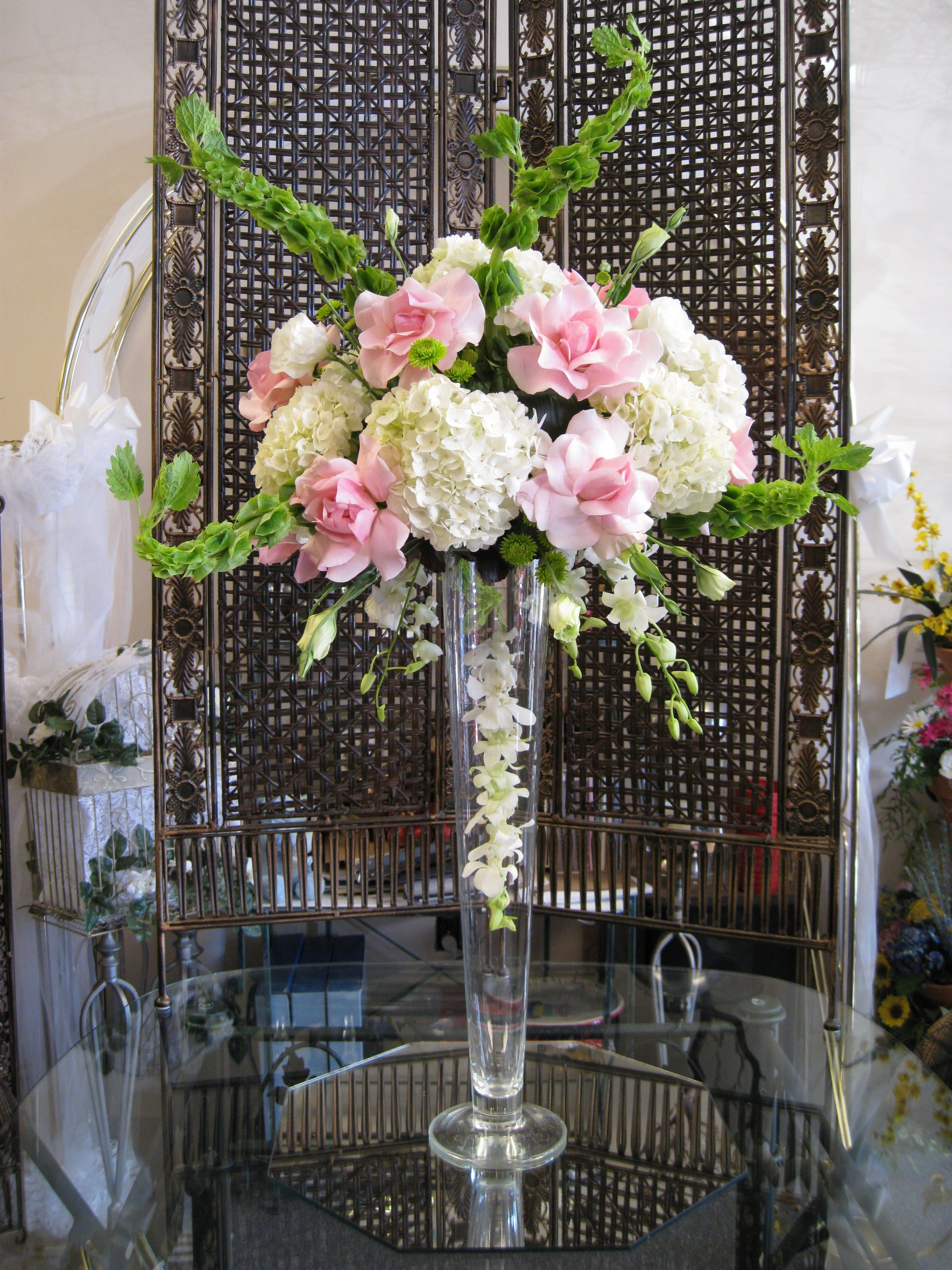 Pink white green wedding centerpiece with roses