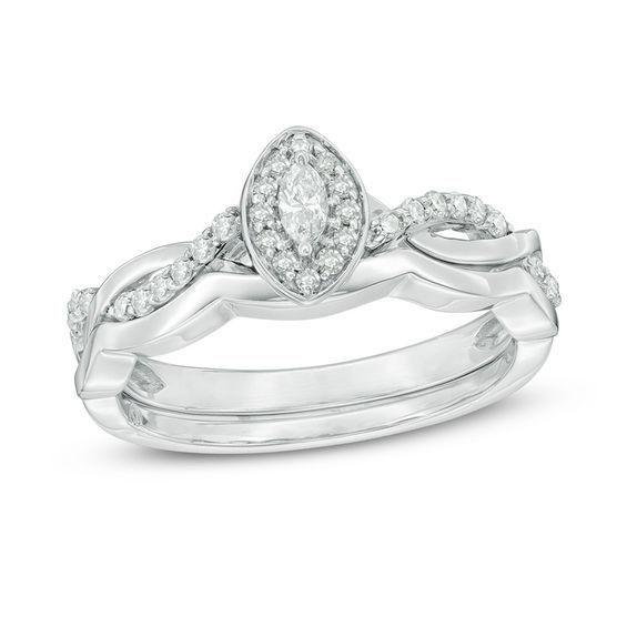 Zales 1/4 CT. T.w. Diamond Three Stone Frame Twist Bridal Set in Sterling Silver foQpal