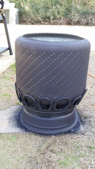 Fire pit made from an old washer drum, tire rim and horse shoes.  For the Home ...