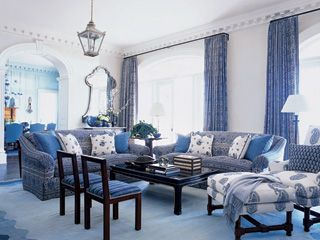 Designer Phoebe Howard Advises Mixing Blue By Sticking With One Hue And Varying Its Intensity Despite The Layered Patterns This Living Room Still Exudes