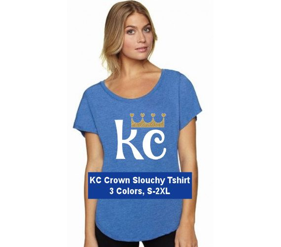 Support your Kansas City Royals with this adorable KC Crown slouchy off-shoulder tshirt! Available in 3 shirt colors with a gold glitter crown! You