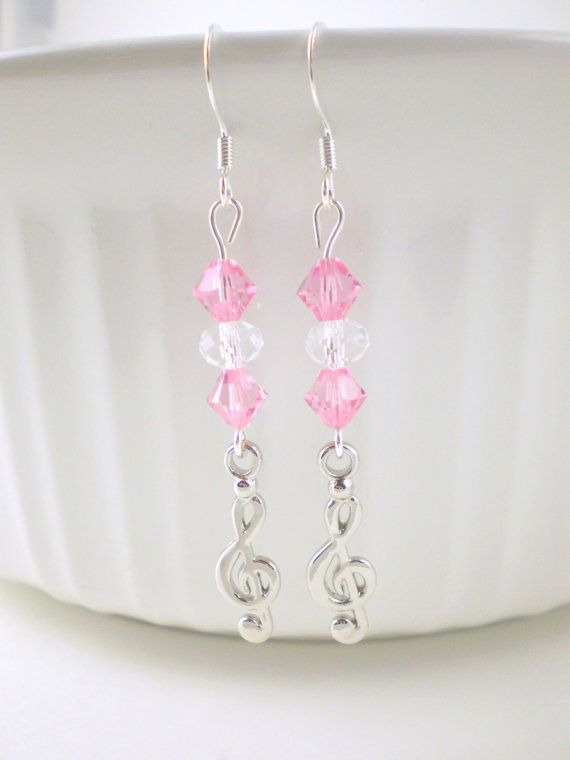 These sweet, pink earrings feature the beautiful and popular pink swarovski beads, crystal color beads, and cute treble clef charms. These pink music earrings are perfect for anyone who loves music and will make an excellent gift. The earrings are sent in a cute organza bag making it ready for gift-giving.  LENGTH: 2 & 1/4 inches total (ear wire to end of charm)
